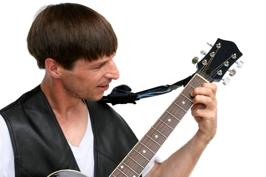 A good-looking guy playing guitar - isolated.