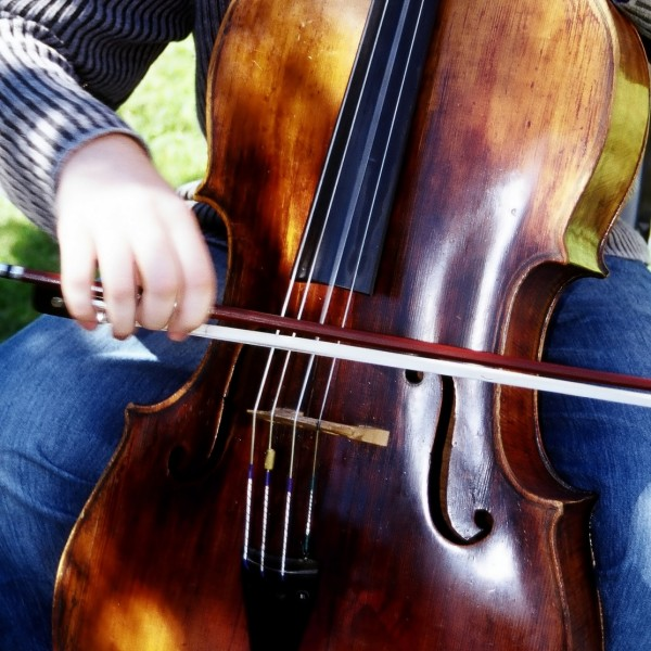 musician playing a cello at rehearsal